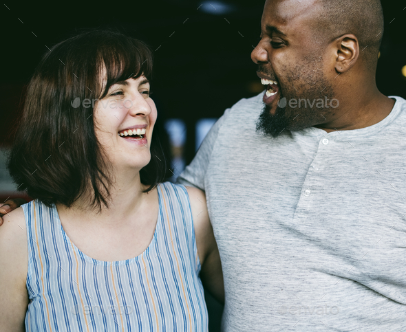 Happy couple laughing together - Stock Photo - Images