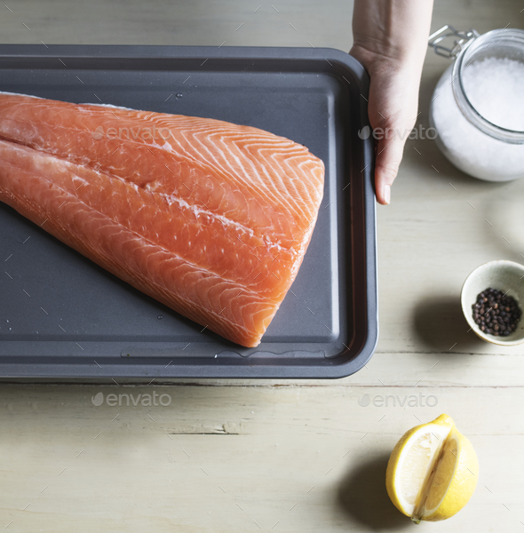 Raw salmon on a tray food photography recipe idea - Stock Photo - Images