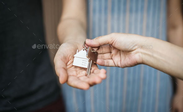 Woman buying a new house - Stock Photo - Images