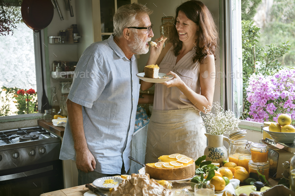 Lovely couple baking cheescake in the kitchen - Stock Photo - Images