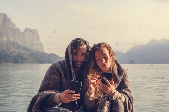 Couple staying connected through social media - Stock Photo - Images