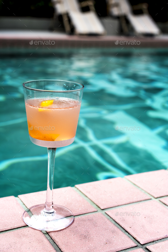 Cocktail drink by the pool - Stock Photo - Images