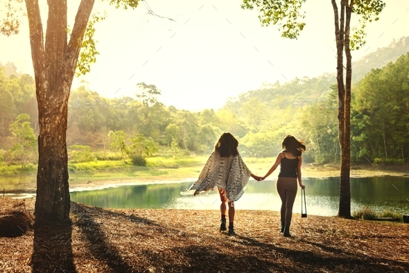 Friends hanging out in a forest - Stock Photo - Images