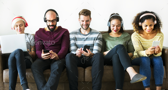 Group of people enjoying music streaming - Stock Photo - Images