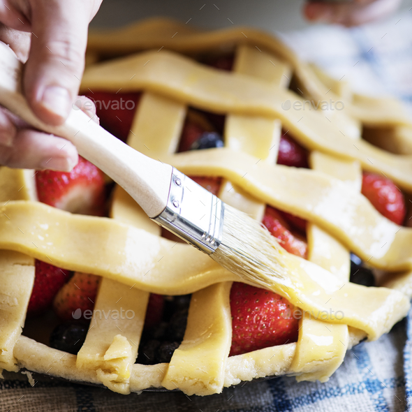 A person baking fruit pie food photography recipe idea - Stock Photo - Images