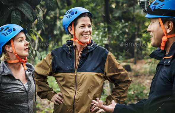 Diverse friends trekking in the forest together - Stock Photo - Images