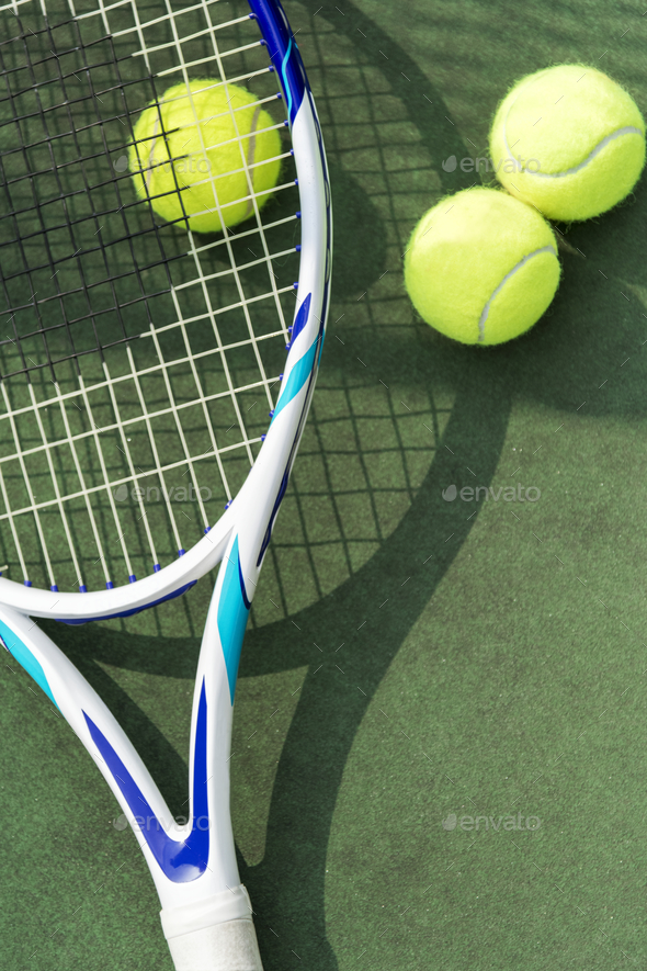 Tennis balls on a tennis court - Stock Photo - Images