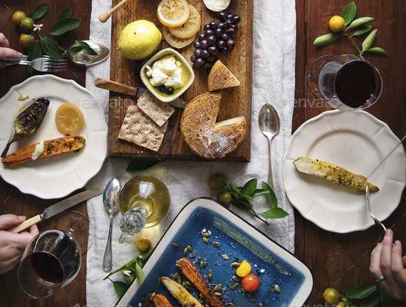 A couple eating a cheese platter food photography recipe idea - Stock Photo - Images