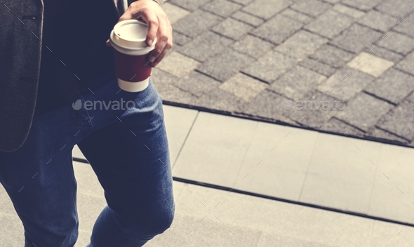 Person holding hot coffee cup - Stock Photo - Images