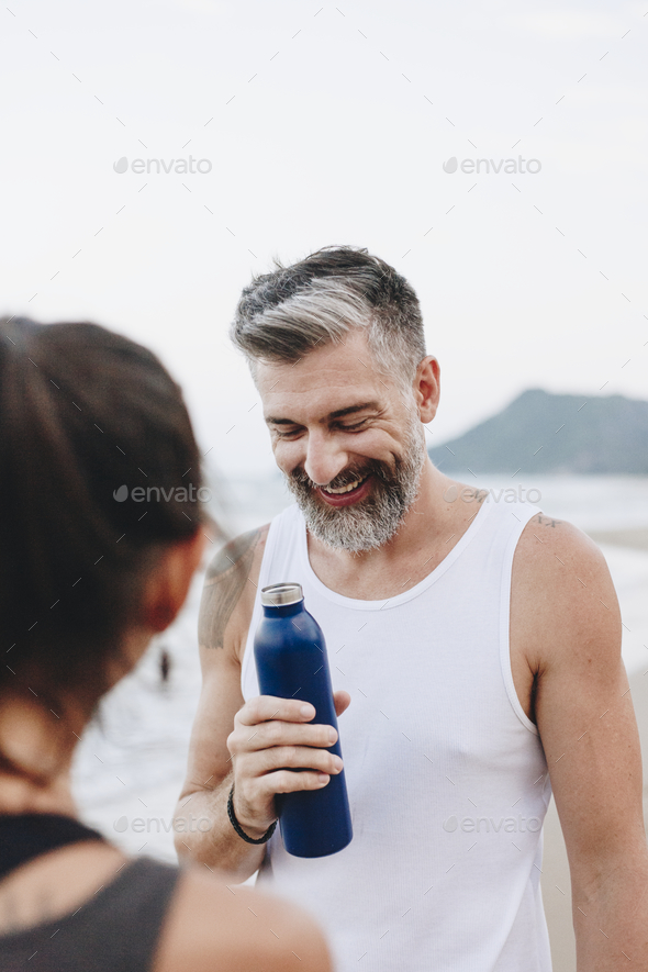 Man drinking water to rehydrate - Stock Photo - Images