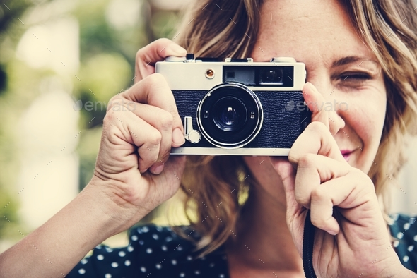 Woman taking picture with camera - Stock Photo - Images