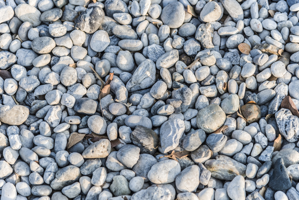 Pebbles and rocks on teh ground - Stock Photo - Images