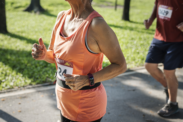 Senior athlete running in the park - Stock Photo - Images