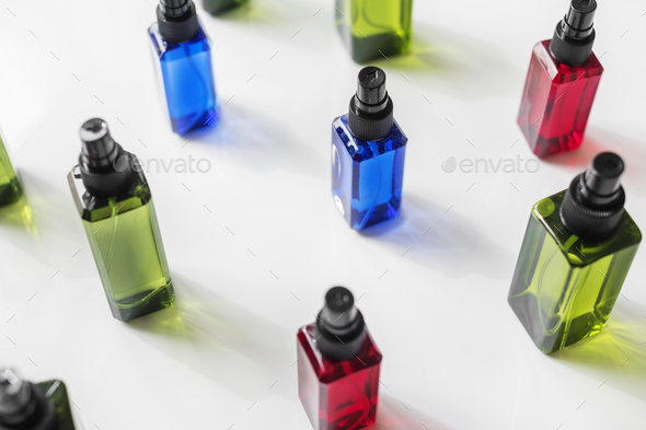 Colorful spray bottles isolated on white background - Stock Photo - Images