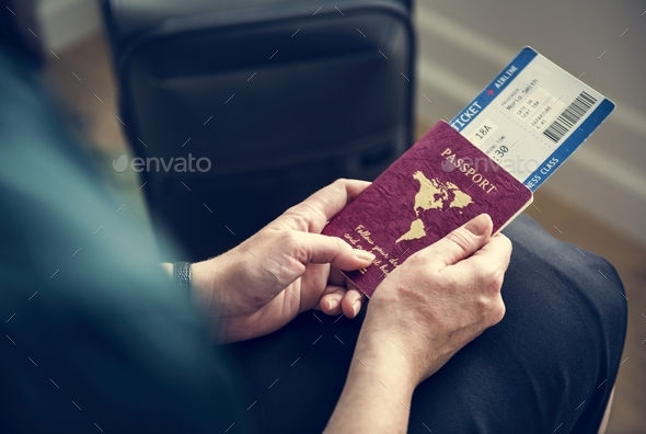 A man preparing to travel - Stock Photo - Images