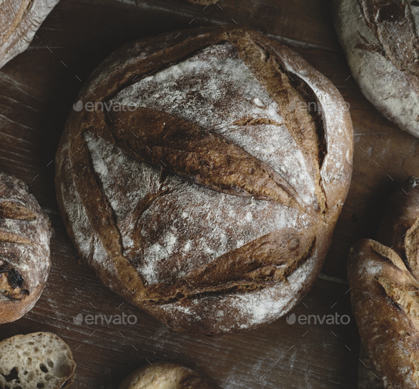 An assortment of bread loaves food photography recipe ideas - Stock Photo - Images