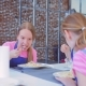 Teenagers Eat Food Sitting at the Table - VideoHive Item for Sale