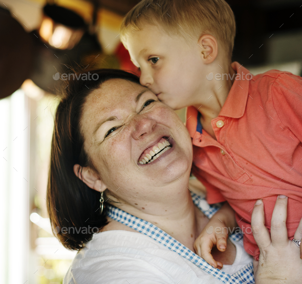 Son kissing mommy in the kitchen - Stock Photo - Images