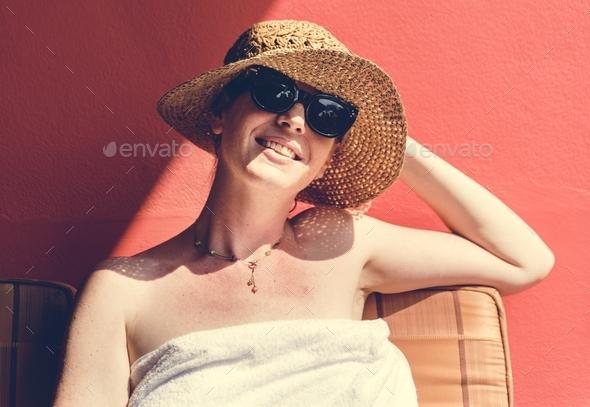 Caucasian woman sunbathing in summertime - Stock Photo - Images