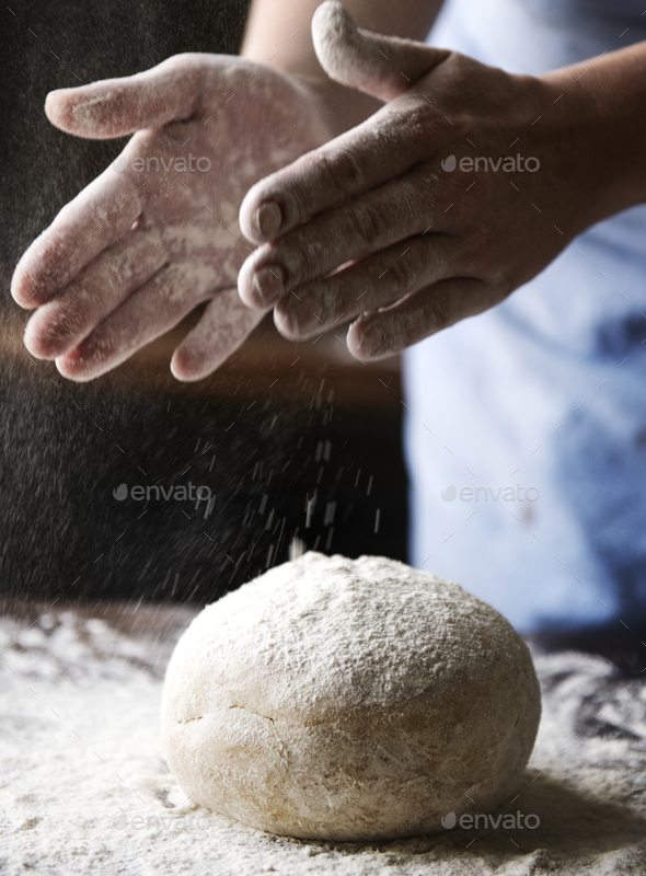 A housewife making a dough - Stock Photo - Images