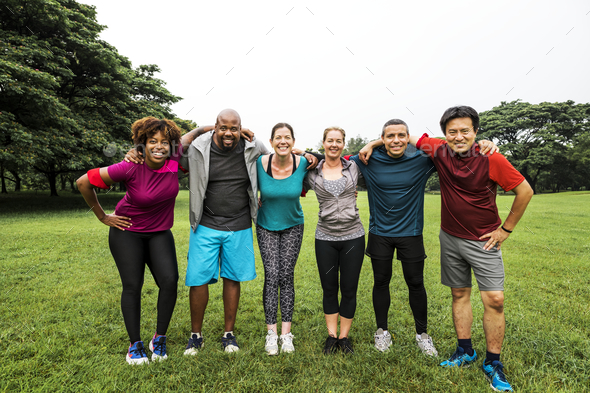 Group of cheerful diverse friends in the park - Stock Photo - Images
