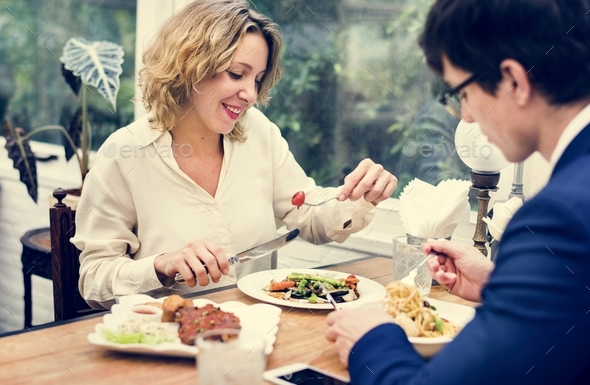 Business couple having dinner together - Stock Photo - Images
