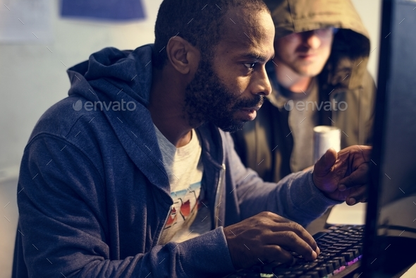 African descent man working with computer laptop - Stock Photo - Images