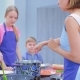 Young People Are Cooking. Children or Teenagers with a Woman in the Kitchen Prepare Food - VideoHive Item for Sale