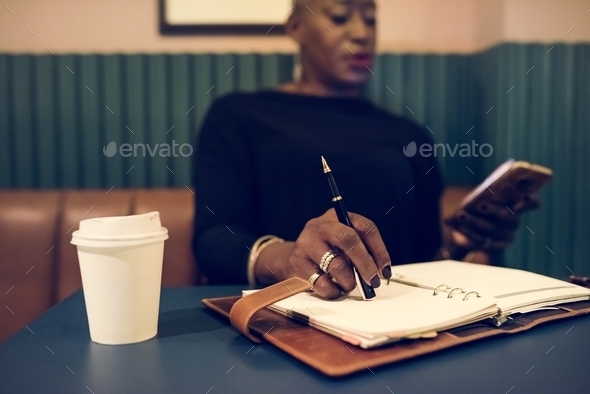 Businesswoman working in cafe - Stock Photo - Images