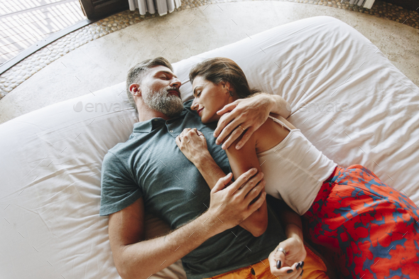 Honeymoon couple relaxing in a hotel room - Stock Photo - Images