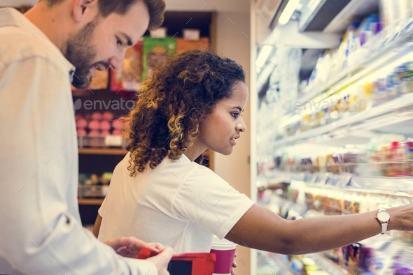 Couple shopping together at a supermarket - Stock Photo - Images