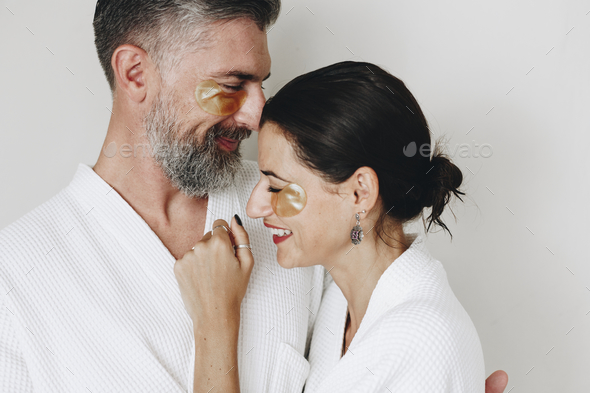 Couple relaxing with golden eye mask treatment - Stock Photo - Images