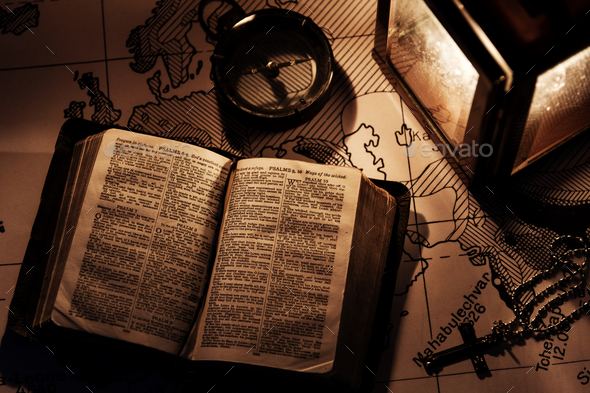 An old bible on a wooden table - Stock Photo - Images