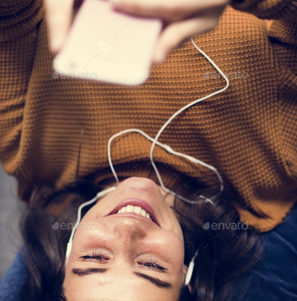 Young woman listening to music - Stock Photo - Images
