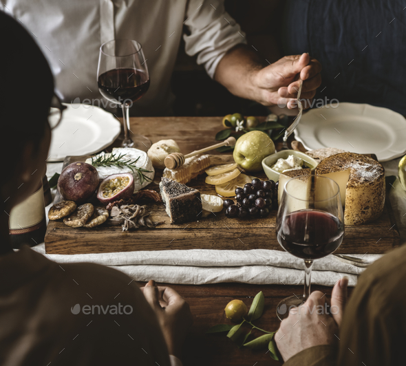 People enjoying a cheese platter food photography recipe idea - Stock Photo - Images