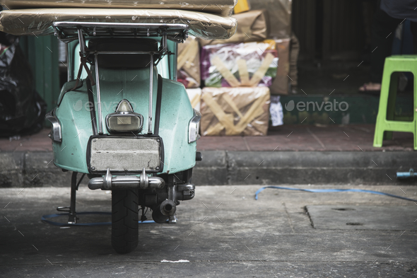 Old scooter parked on a street - Stock Photo - Images