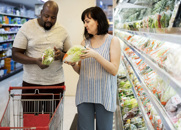 Couple shopping at a supermarket - Stock Photo - Images