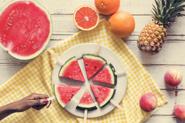 Freshly slice watermelon on sticks - Stock Photo - Images