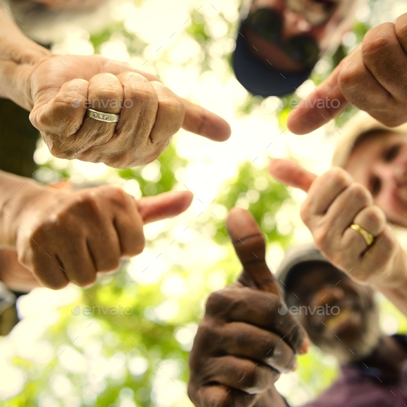 Group of senior friends outdoors thumbs up positivity concept - Stock Photo - Images