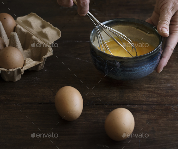 Woman whisking eggs food photography recipe idea - Stock Photo - Images