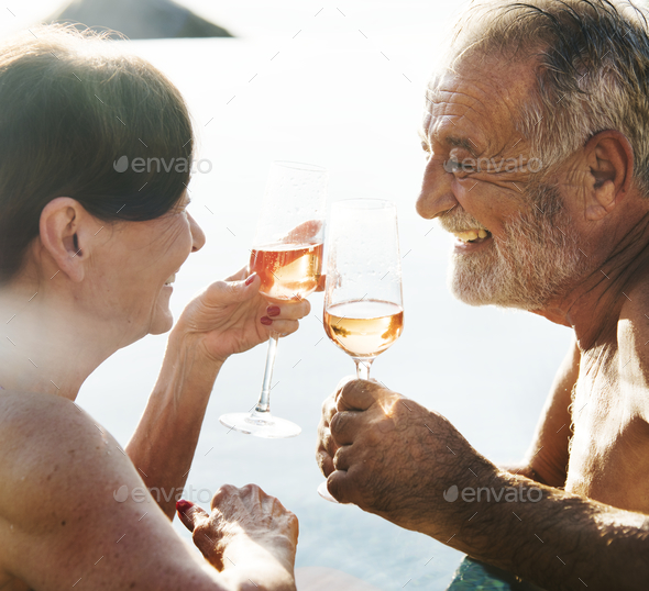 A senior couple toasting - Stock Photo - Images