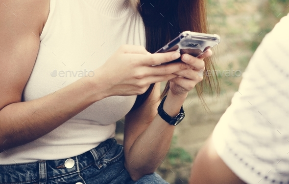 Girl texting on her smartphone - Stock Photo - Images