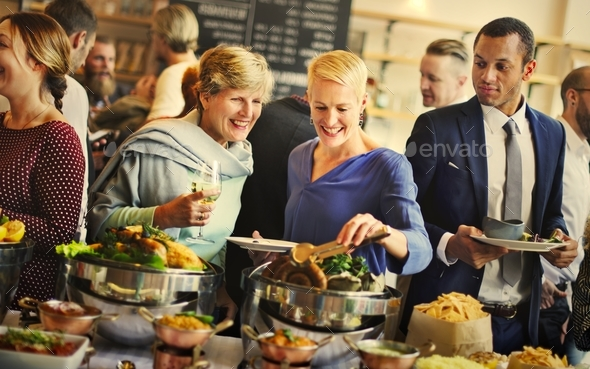 Group of diverse people are having lunch together - Stock Photo - Images