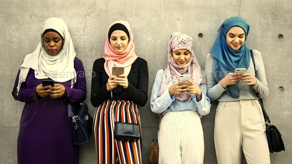 Group of islamic girls using smart phone - Stock Photo - Images