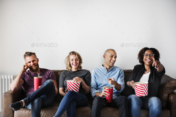 Group of friends having a great time watching movie - Stock Photo - Images