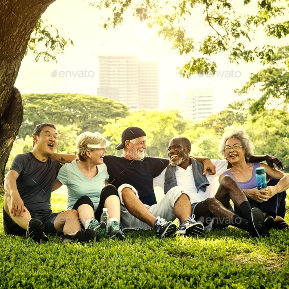 Group of senior friends relaxing together after an excercise - Stock Photo - Images