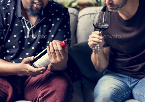 Man tasting red wine with friends - Stock Photo - Images