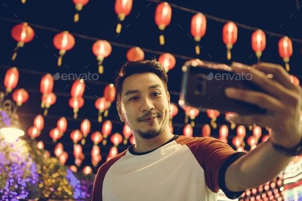 Man taking selfie at lantern festval - Stock Photo - Images