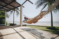 Couple relaxing in a hammock by the beach - PhotoDune Item for Sale
