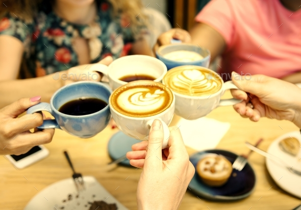 Friends having coffee together - Stock Photo - Images